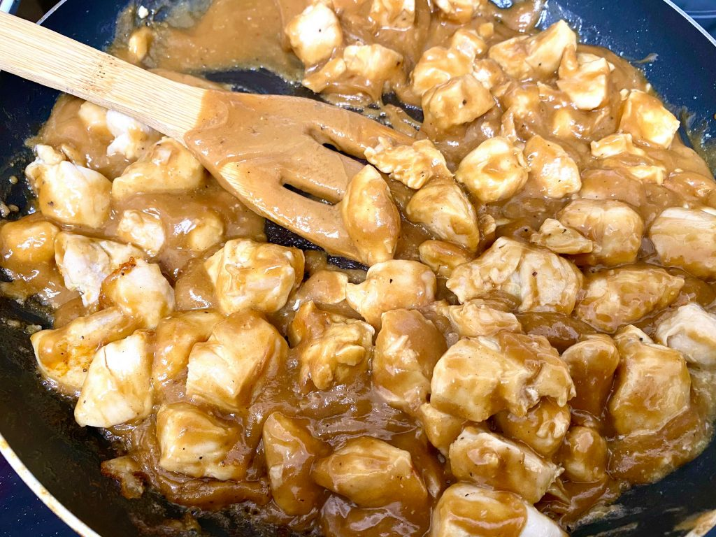 chicken coated in peanut butter sauce