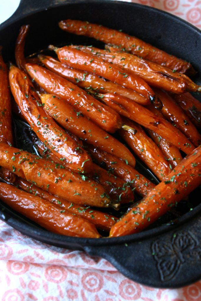 baked brown sugar carrots in a cast iron pan