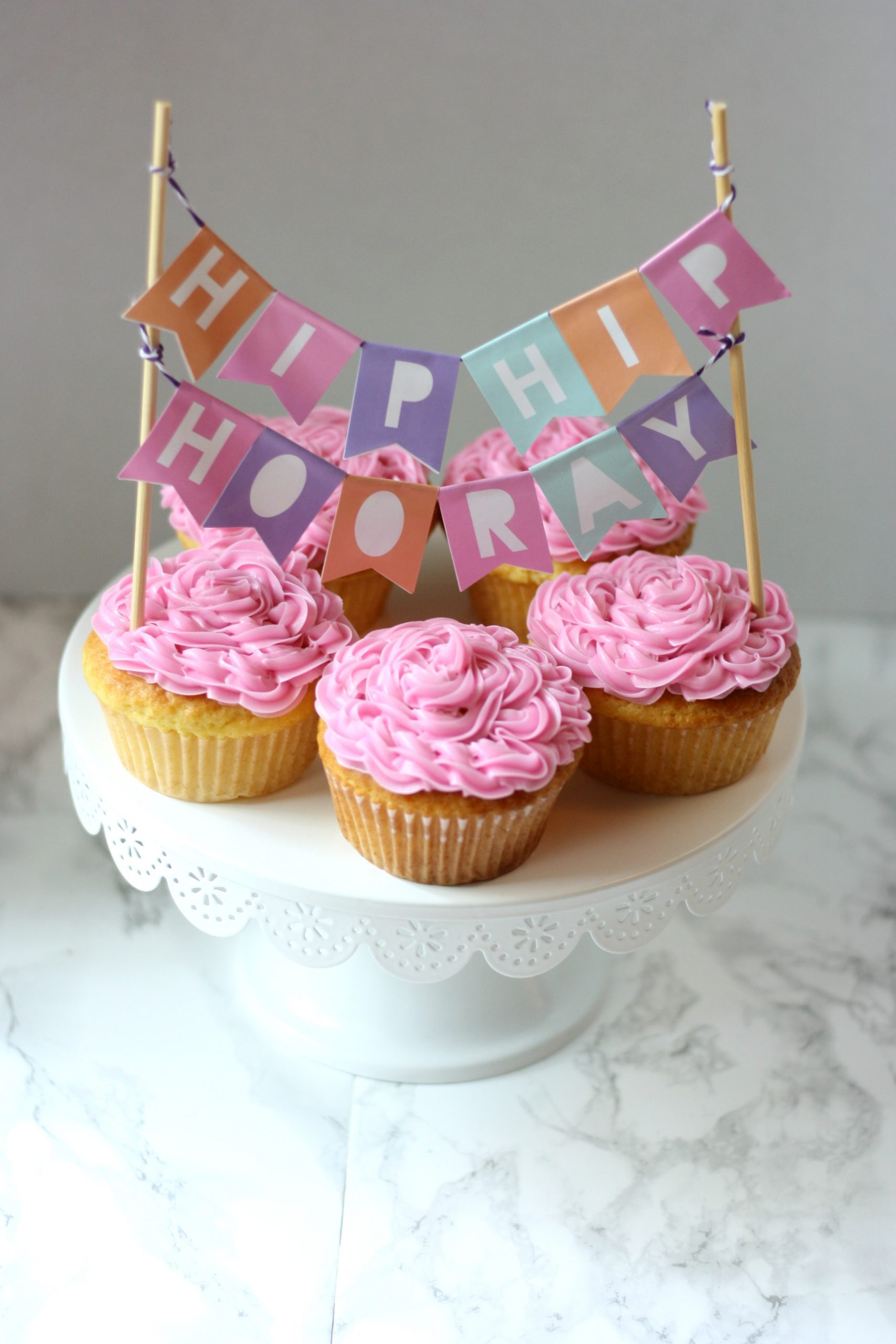 confetti surprise cupcakes with hip hip hooray sign