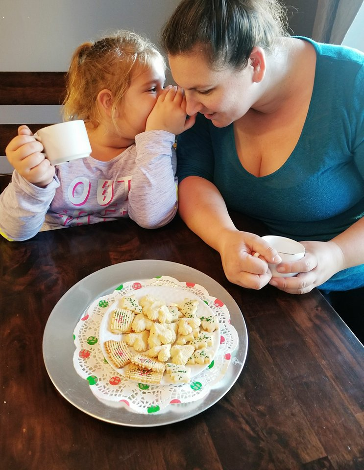 mom and daughter having cookies