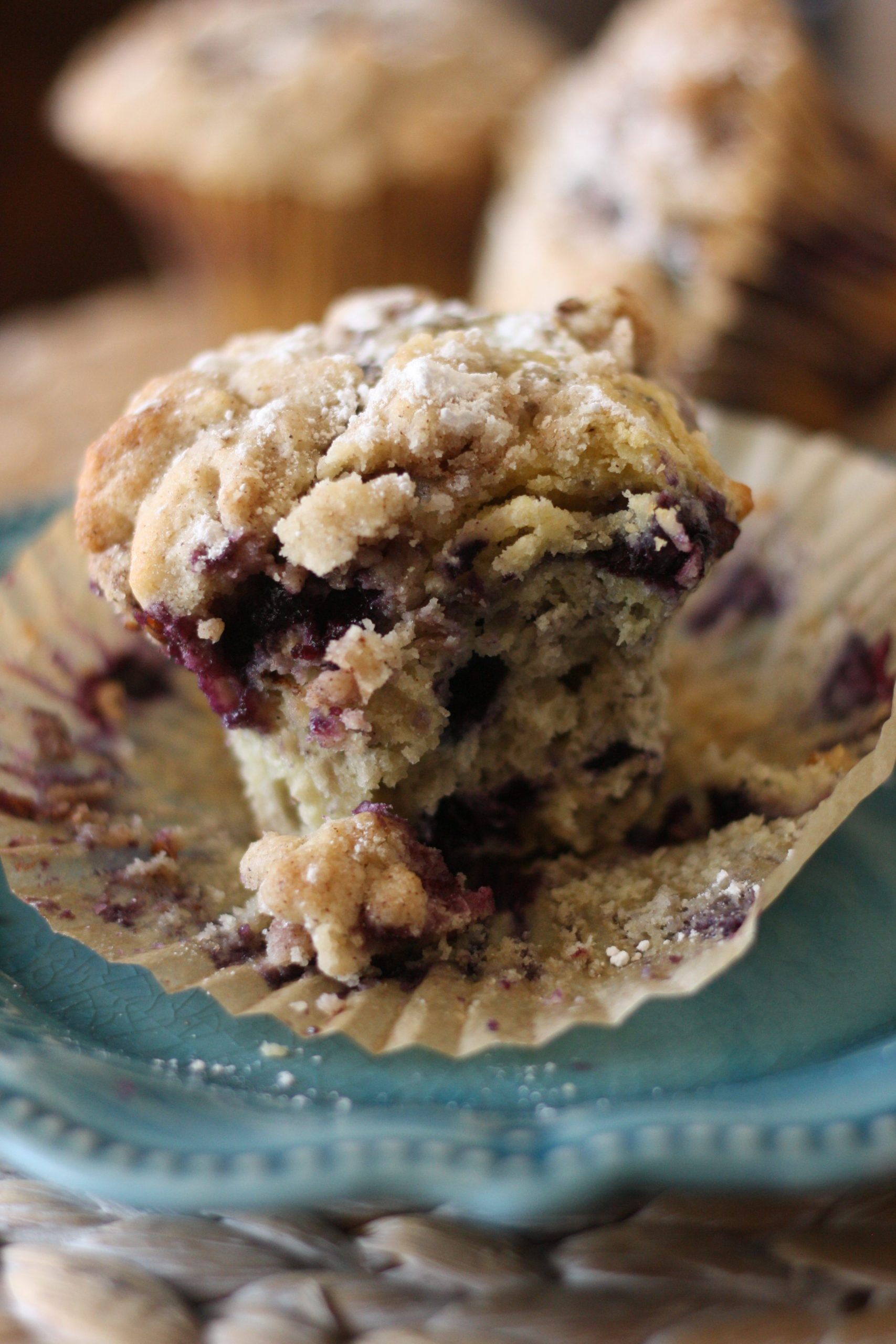 blueberry crumb muffins on a blue plate