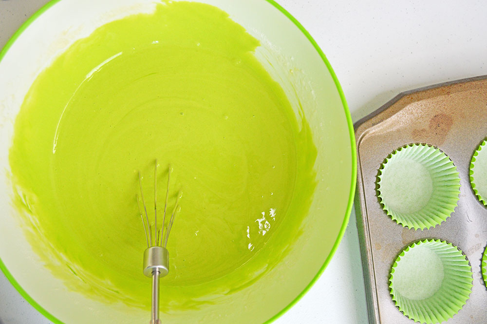 green cake batter in a bowl