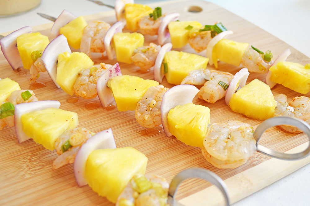 Chili Lime Pineapple & Shrimp Skewers on a cutting board