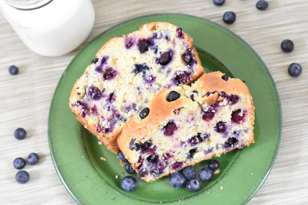 blueberry bread on a green plate
