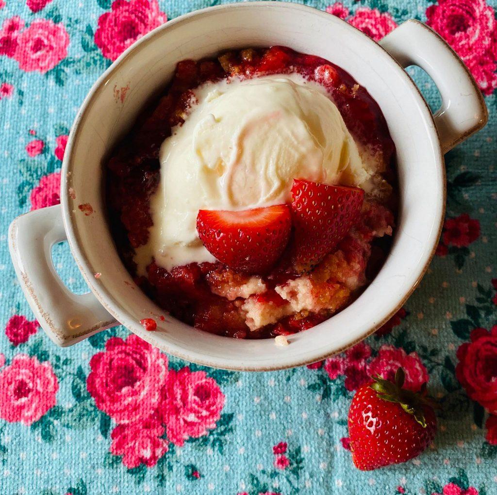 strawberry shortcake dump cake with vanilla ice cream