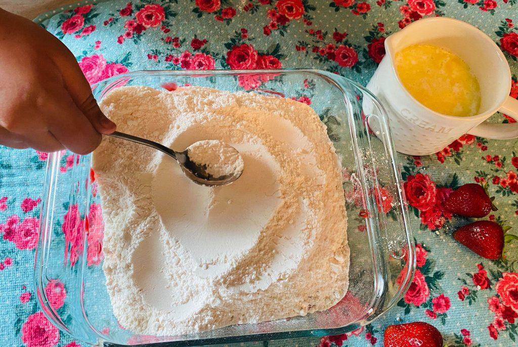 cake batter over strawberry pie filling