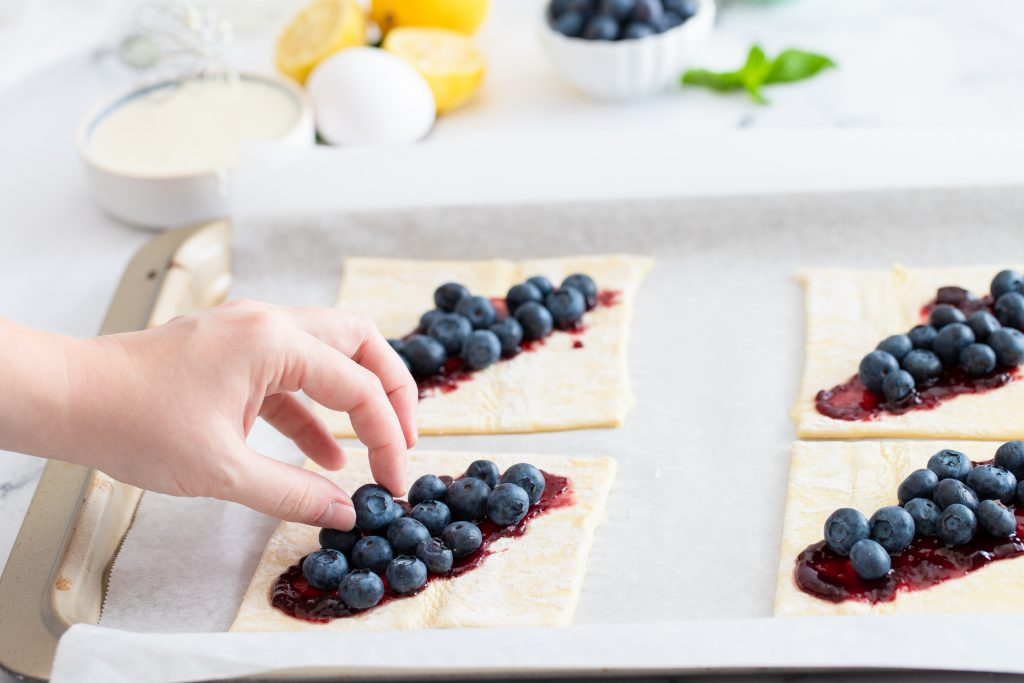 blueberries on the center of the puff pastry