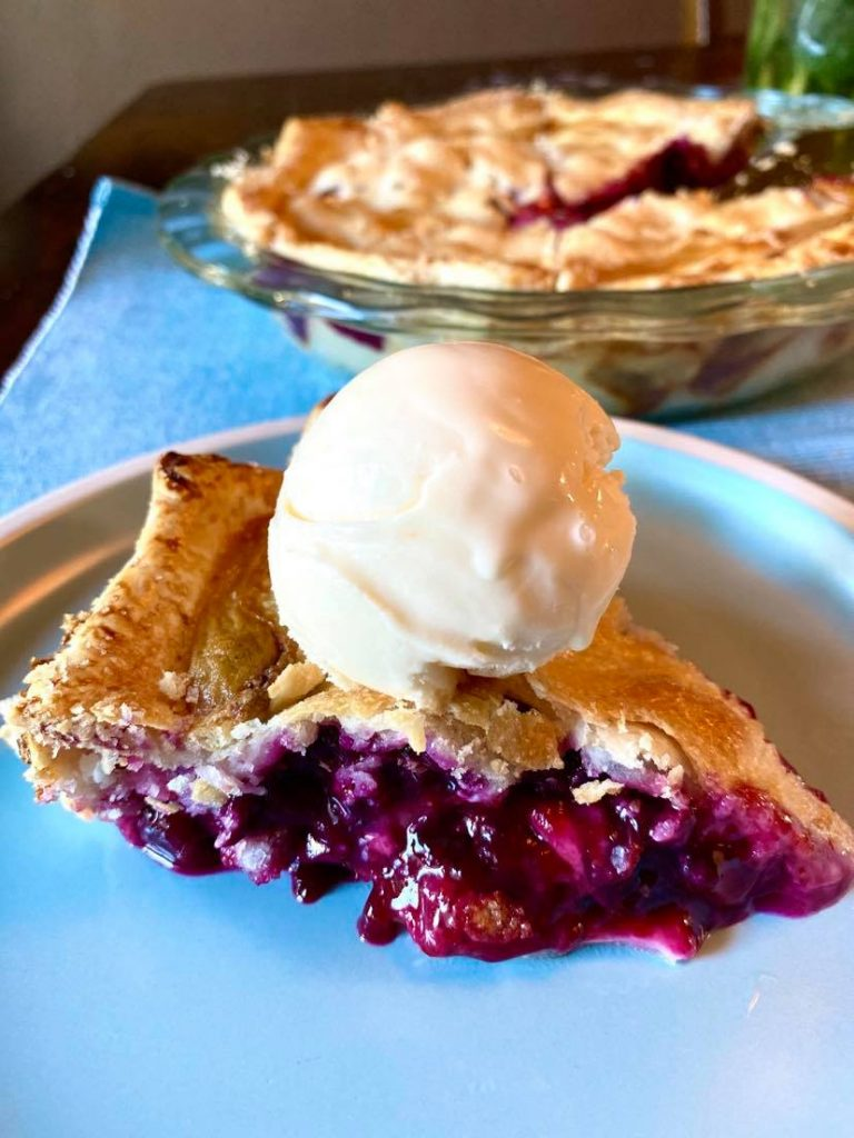 blueberry pie with vanilla ice cream on top