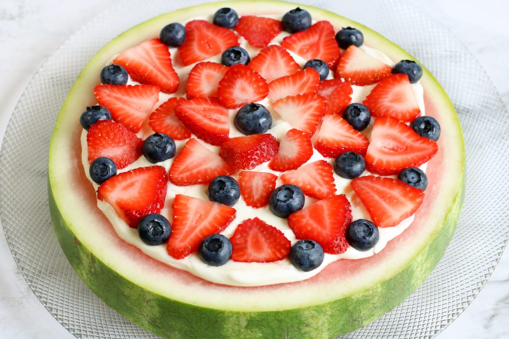 Decorate watermelon pizza as desired with fruit