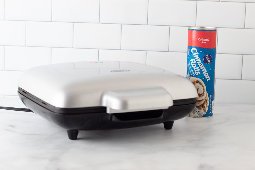 waffle maker and cinnamon roll can