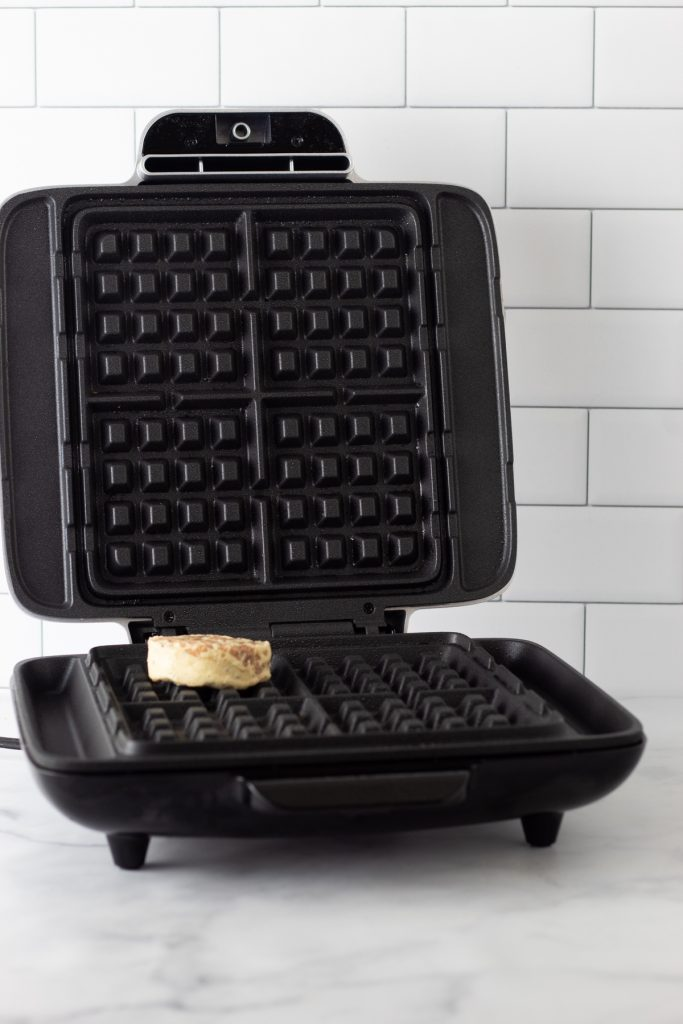 waffle maker with a cinnamon roll on it