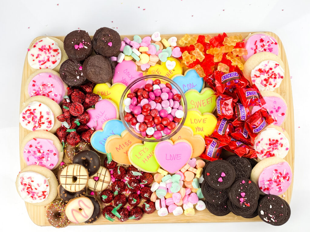 Learn how to make the perfect Valentines Charcuterie Board, full of your favorite sweets and snacks! It's the perfect way to celebrate.