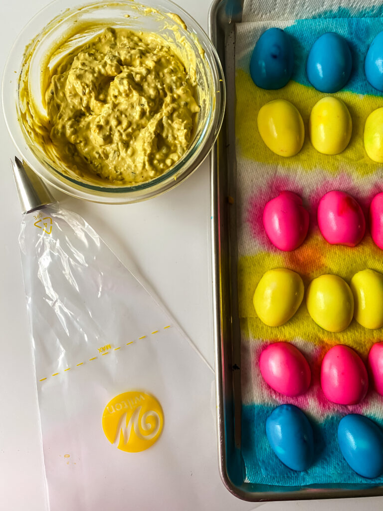 Remove the yolks with a spoon and place in bowl.