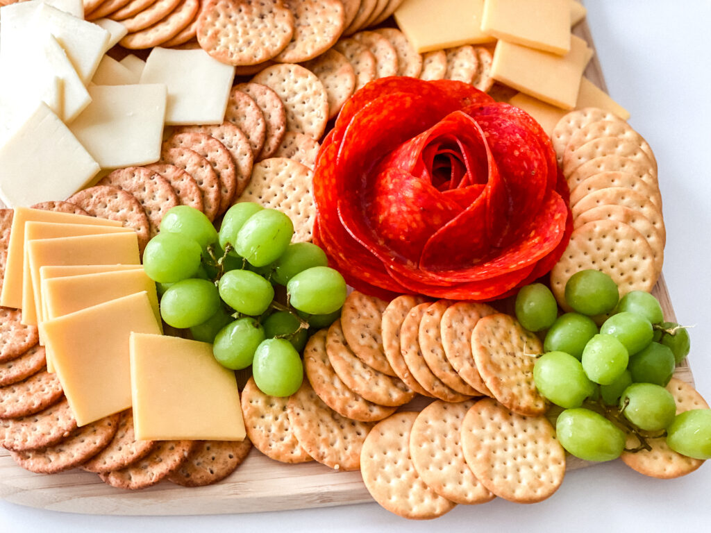 Learn how to easily create the viral Tik Tok food hack to making Salami Roses to put on a charcuterie board!