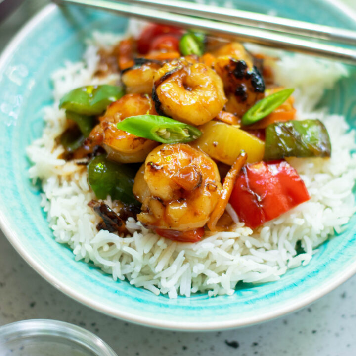 sweet and sour shrimp on blue plate