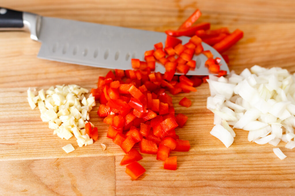 diced garlic, peppers and onions