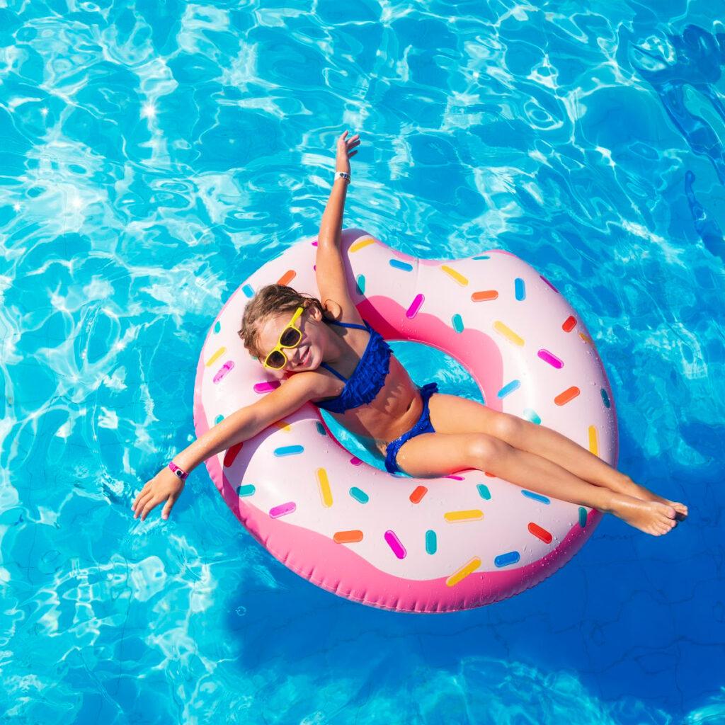 girl in pool float