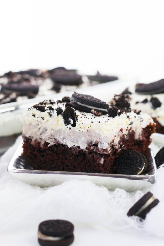 This easy oreo poke cake recipe is perfect for a no-fuss dessert. It only takes a few minutes and a little effort to whip up this indulgent, chocolatey dessert.